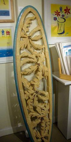 Carved wood panel in the shape of a surfboard. Awesome.