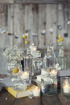 Glass jars and books for the centerpiece