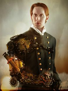 Military Steam punk fella. This could be a lot of fun for the guys... we could do some great choreo... Military style with fire!!