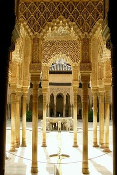 The Courtyard of the Lions in the heart of the Alhambra, the Moorish citadel formed by a complex of palaces, gardens and forts in Granada, Spain.