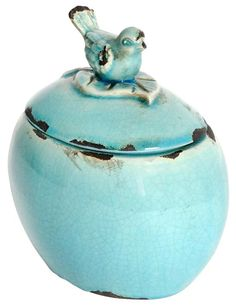 """The Bluebird Lidded Jar is a simple, fun way to add instant vintage style and a splash of color to your home. The accent piece is finished in a beautiful turquoise color with a distressed, crackled look."" $14"