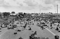 "April 30, 1975 Combat boots litter the road on the outskirts of Saigon, abandoned by ARVN soldiers who shed their uniforms to hide their status. ""I'll never forget the shoes and the loud 'thump, thump, thump' sound as we drove over them,"" recalled the photographer. ""Decades of war were over and we finally had peace."" IMAGE: DUONG THANH PHONG"