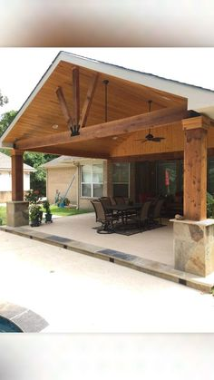 Photo of Backyard Paradise Luxury Pools - Montgomery, TX, United States. Gable roof patio cover attached to existing house with cedar beams and posts, flags or column base, and wood stained ceiling Outdoor Spaces, Outdoor Living, Covered Patio Design, Covered Back Porches, Backyard Covered Patios, Covered Back Patio, Covered Decks, Gazebos, Backyard Patio Designs