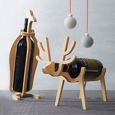 penguin or reindeer wine rack by array | notonthehighstreet.com