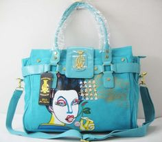 Just in time for a nice weekend out of town or work day, Christian Audigier delivers this chic weekender bag...
