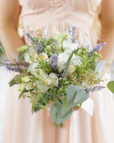 Each bridesmaid toted a bouquet of blush roses, eucalyptus, lisianthus, and lavender.