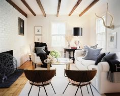 Modern fancy version of what my new place looks like. trying to get ideas without having to do much painting and renovating. Living room - grays, blacks, whites, natural wood, white brick!