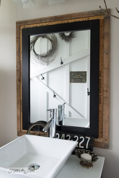 Yardstick mirror frame / Salvaged farmhouse bathroom makeover via www.funkyjunkinte...