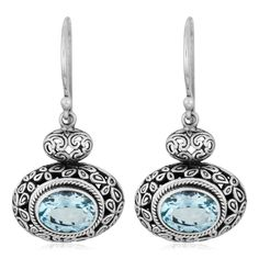 Your lobes will look stunning when you wear these dazzling silver dangle earrings to your next special event. These gorgeous topaz earrings were handcrafted by artisans in Indonesia, so they are sure to add a nice touch to any outfit you wear them with.