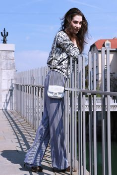 Fashion blogger Veronika Lipar of Brunette From Wall Street sharing casual chic Friday outfit in wide-leg trousers