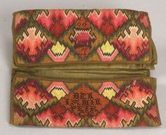 """Wool Needlework Pocketbook - Wool Needlework Pocketbook, America, 1790, double pocketbook worked in Irish stitch in a diamond pattern with geometric centers in shades of green, red, yellow and blue, cross stitch lettering """"BENJAMIN PIERCE 1790,"""" olive green glazed wool lining and wool-twill tape edging, (minor losses), folded 4 5/8 x 9 in."""