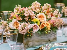 Wooden boxes add rustic charm to your centerpieces.Photo Credit: Caroline Ghetes / Event Design: Events of Distinction / Flowers: Michael Daigian Design