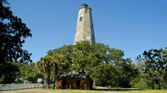 "Bald Head Island, NC ""Take the ferry from Southport, NC, and hop aboard a golf cart to explore the live oak-lined, winding roads of Bald Head Island. After catching some rays on any one of the island's 14 miles of beaches, climb to the top of Old Baldy, the oldest lighthouse in North Carolina."