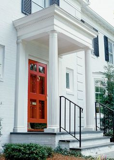 Stately plantations will inspire the curb appeal of your new home. Add a splash of BEHR red paint to your front door or brighten up brick with a fresh coat of Ultra Pure White for a breathtaking result. Red Paint Colors, Exterior Paint Colors, Exterior Design, Front Door Steps, Front Doors, House Painting Cost, Georgian Style Homes, Paint Shades, Facade House
