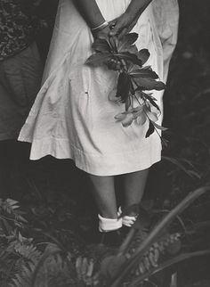 """zzzze: """"W. Eugene Smith untitled, [hands and legs of nurse holding flowering branches behind her back], 1954, Gabon, Lambaréné Gelatin silver print """""""