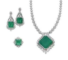 A SET OF EMERALD AND DIAMOND JEWELLERY   Comprising a necklace, the pendant centering upon a large square-cut emerald, within a marquise-shaped and brilliant-cut diamond surround, to the brilliant-cut diamond flower link chain, a pair of ear pendants and a ring en suite, mounted in gold