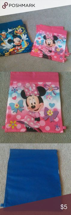 "Lot of 7 bags Lot of 7   4- Mickey Mouse  3-Minnie Mouse  They were backpacks but all of the ties were tangled. They would make great party bags, cut the bottom tabs off and put a cute ribbon through the top hem.  13"" tall x 11"" wide  Never used Other"
