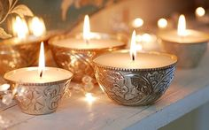 Pretty silver votive candles... these would look amazing scattered on a mantlepiece in front of a mirror, or along a mirror runner on a dining table.