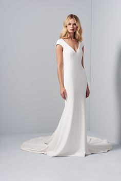 Allison Webb bridal gown - Ivory stretch crepe fit to flare gown with V-neck, cap sleeves and illusion back with buttons. Organza overskirt with pearl embellishment and bow at back, Sweep train. Overskirt available in ivory and black. Crepe Wedding Dress, Fit And Flare Wedding Dress, Crepe Dress, Wedding Dresses, Yes To The Dress, Wedding Attire, Designer Collection, Illusion, Cap Sleeves