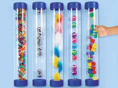 """Giant Sight & Sound Tubes    A fascinating, hands-on way for tots to explore sight and sound! Each see-inside tube is filled with objects of different colors, weights, shapes and sizes—like feathers, balls, bells and sparkly gems—so kids get a variety of fun sensory experiences! Durable plastic tubes are permanently sealed for added safety. Set of 5; each measures 16"""". AA931 • $69.95"""