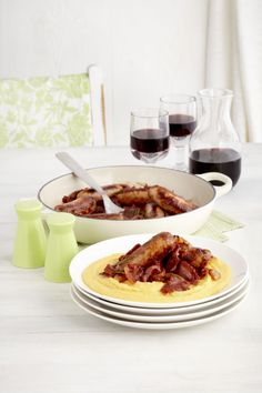 Braised Italian sausages with soft polenta. Recipe on memory stick