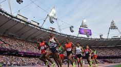 Mo Farah of Great Britain leads the pack as they compete in the men's 5000m