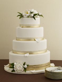 Classic White and Gold Wedding Cake (Best Wedding and Engagement Rings at www.brilliance.com)