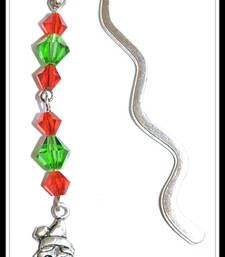 A Santa charm along withcrystal beads hangs from a designer bookmark. The bookmark is a shepherd hook style.