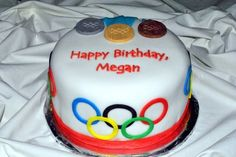 Olympics themed birthday cake. A rich chocolate cake with buttercream frosting. The cake is covered with fondant and the decorations are also hand cut fondant.