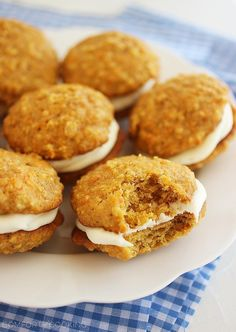 Soft Carrot Cake Sandwich Cookies – Soft, cinnamon-spiced carrot cake cookies with an easy cream cheese frosting. Hard to resist for carrot cake lovers!   thecomfortofcooking.com