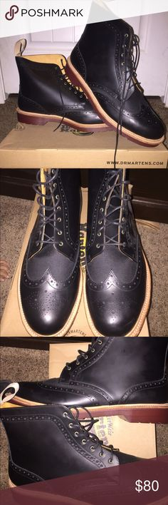 NIB Dr Martens wingtip work boots Black leather. High top for ankle support. Oil, fat, acid, petrol, and alkali resistant. Air cushion sole. Heston 3989 style. Wingtip and brogue detailing for a dressier style. Brand new never used. Comes in box. Dr. Martens Shoes