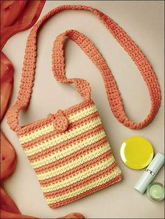 "Stitch a fashionable shoulder bag to accessorize your wardrobe. Size: Approximately 5 1/2"" x 6"". Made with medium (worsted) weight yarn and size G/6/4mm hook.Skill Level: Beginner"
