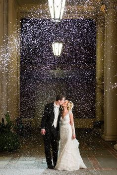 Snow machine for a winter wedding with a snow exit. Biltmore ballrooms wedding in Atlanta. Photography by Rick+Anna. www.rickplusanna.com