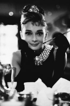 What's more glamorous than Hepburn in this black dress, cigarette holder placed elegantly in hand, jewelry dripping from her neck as…