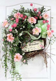 Spring wreath ~ I like how this one defies the traditional form and spills over the bottom