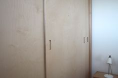 sliding doors, birch plywood wardrobe designed by 1934