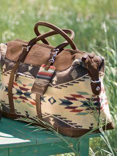 62e1ebc1b90 I m obsessed with big, leather, tribal print, weekenders. Pendleton Bag