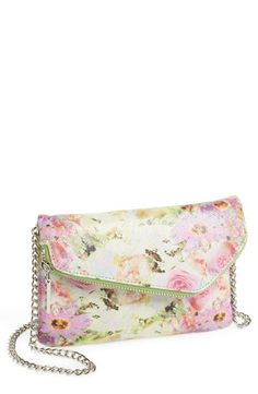 Can't get enough of floral prints this season. This crossbody is great for bringing spring to an outfit.