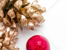 Pinecones and Red Ball - Two golden pinecones with a red ornament.