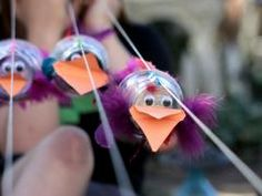 Make these birds using feathers, disposable cups, paper and glue. then jump, swing, and bounce them down the string to the finish line! School Age Crafts, School Age Activities, Preschool Arts And Crafts, Craft Activities For Kids, Fun Crafts, Preschool Science, Preschool Ideas, Craft Ideas, Green Crafts For Kids