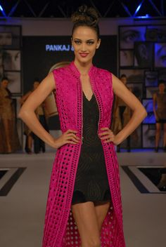 She grabs your attention and then teases with her sensuality. Angela Jonasson walks for Pankaj and Nidhi.