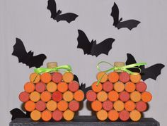 - Hand painted wine corks shaped into a pumpkin with a natural cork stem and…