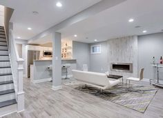 Turning an unfinished basement into extra living space? Learn what to do when finishing basement walls to achieve quality, comfortable conditions. Gray Basement, Basement Paint Colors, Basement Painting, Basement Living Rooms, Modern Basement, Basement Flooring, Grey Flooring, Basement Bathroom, Flooring Ideas