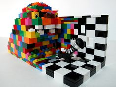 "this LEGO creation is called ""Color Impact""  i like it. i like the wave of color taking over the black and white world. it's a cool concept...and even cooler cuz it was put into LEGO."