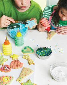 Photo of children decorating winter cookies.