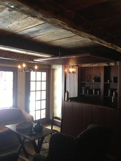 Exposed ceilings done and tavern room re-painted now for the fun...decorating!