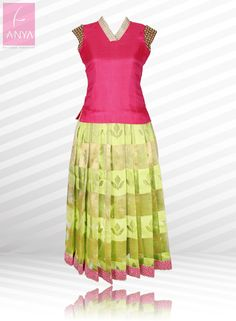 Stylish and classy silk pattu pavadai highlighted with embroidered sleeves and collared neckline.