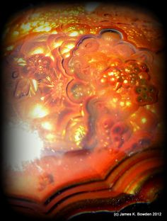 A beautiful galaxy fits within this Mexican Fire Agate cabbed by James K. Bowden. Mexican Fire Agate Cab shaped by James K. Bowden.  #cabechon #lapidary #jewelry #fireagate