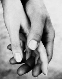 holding hands with intertwining fingers.
