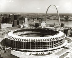 This historic photograph showing the St. Louis Cardinals' baseball stadium and the Gateway Arch was taken by Ted McCrea on September 21, 1967. It's part of the Ted McCrea Collection at the Missouri Historical Society, St. Louis. St Louis Baseball, St Louis Cardinals Baseball, Baseball Park, Stl Cardinals, Baseball Photos, Busch Stadium, Gateway Arch, St Louis Mo, Missouri